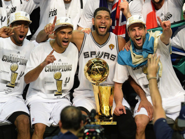 The San Antonio Spurs celebrate with the Larry O'Brien NBA Championship Trophy after the Spurs defeated the Miami Heat 107-84 in Game 5 of the NBA Finals to win the NBA Finals Championship, June 15, 2014 in San Antonio,Texas.  From left are: MVP Kawhi Leonard, Tony Parker, Tim Duncan, Manu Ginobili and Patty Mills.   The Spurs won the best of seven series 4-1.  AFP PHOTO / Robyn BeckROBYN BECK/AFP/Getty Images